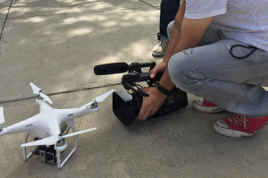 Before Ben Walton flies the device, Aaron Osborne records footage of UF's drone for the video accompanying this story.