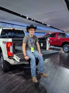 Sophomore journalism/digital media major and western equestrian major, Grant Goetscheus, at NAIAS