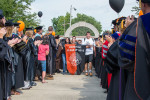 Members of the entering Class of 2015 march through the Griffith Memorial Arch.