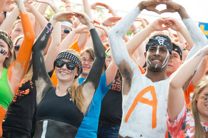 Students cheer on the Oilers football team at the 2014 Homecoming game.