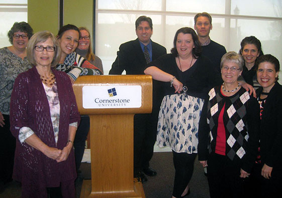 Joanna Schrecengost (right of podium) reunited with friends from her MA TESOL class during a conference at Cornerstone University.