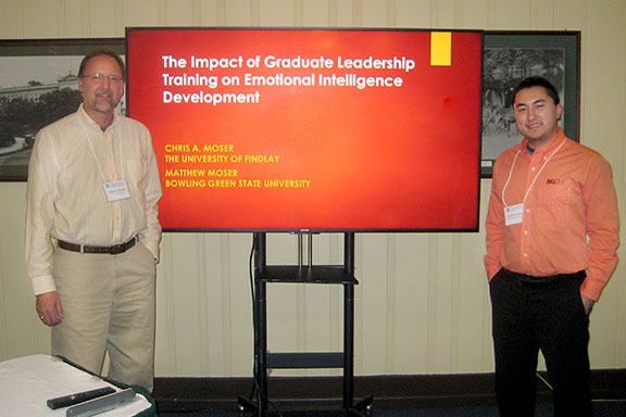 UF professor Chris Moser, Ed.D., (left) and his son Matthew, present together at a spring conference.