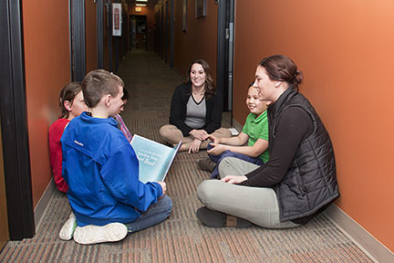 At 1882 Club check-ins, students discuss what they've read.
