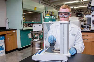 University of Findlay forensic science major Tyler Tomlins working in lab