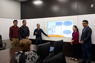 MBA student Ranjeet Timilshina (on right end) with classmates presenting their business plan to Seams Fitting representatives.